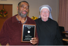With Mother Mary Vincent, Mark Council holds his Jeanne Jugan Award